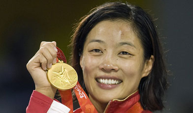 Carol Huynh with her proud Gold